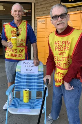 two volunteers collecting donations